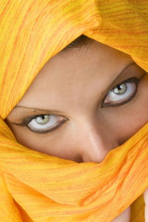 attactive and strong eyes behind an orange scarf used like a burka Stock Photo - 958376