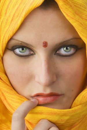 burka: attactive and strong eyes behind an orange scarf used like a burka Stock Photo