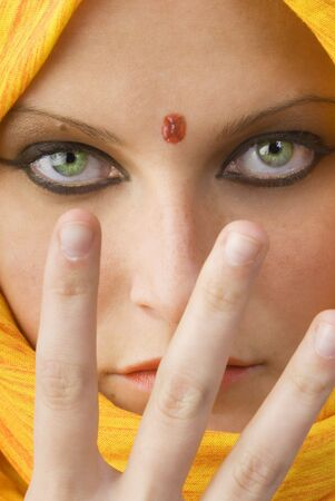 attactive and strong eyes behind an orange scarf used like a burka Stock Photo - 958380