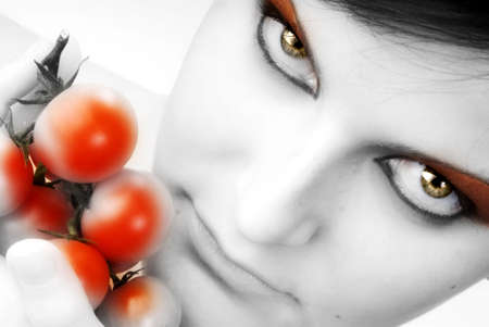 nice portrait of a girl with tomatoes and beautiful  attractive fair eyes Stock Photo - 958384