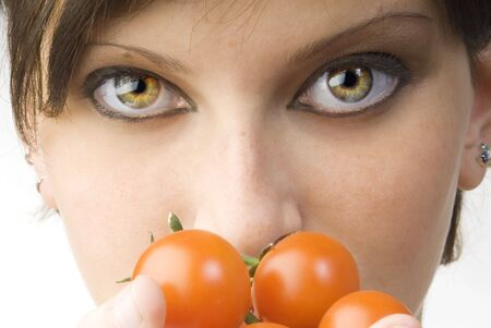 nice portrait of a girl with tomatoes and beautiful  attractive fair eyes photo
