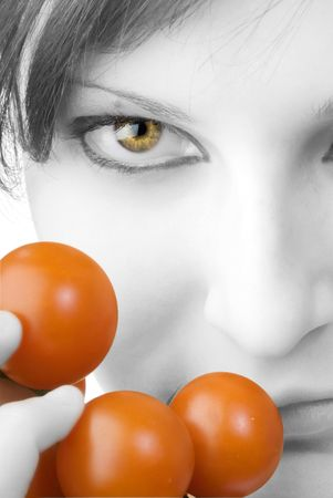 nice portrait of a girl with tomatoes and beautiful  attractive fair eyes Stock Photo - 958387