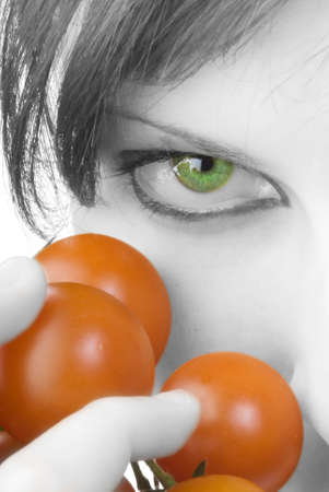 nice portrait of a girl with tomatoes and beautiful  attractive fair eyes Stock Photo - 958388