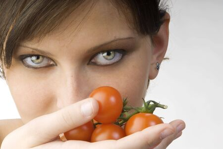 nice portrait of a girl with tomatoes and beautiful  attractive fair eyes Stock Photo - 958389