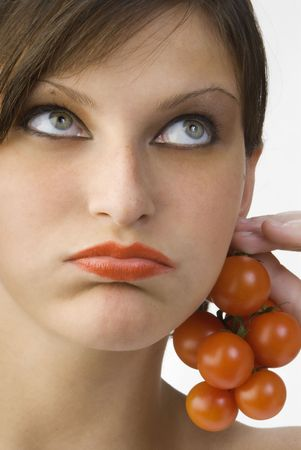 nice portrait of a girl with tomatoes and beautiful  attractive fair eyes Stock Photo - 958390
