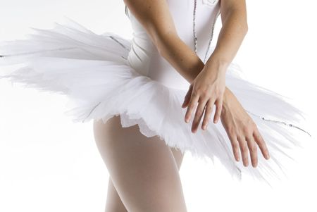 dancer in a white tutu on a white background