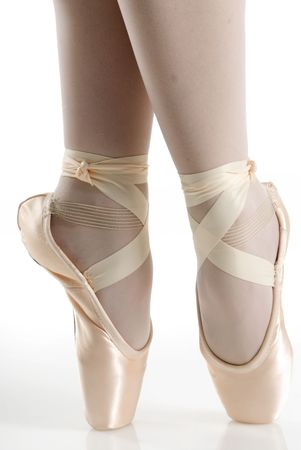 pink shoes: dancer in ballet shoes dancing in pointe Stock Photo