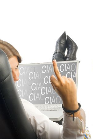 ciao: a white collar worker dressing a white shirt sitting on an armchair working with a computer with a ciao screen saver that you can easy take off Stock Photo