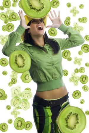 pretty girl with colored dress and pieces of fruit all around her and a big kiwi falling down Stock Photo - 1456905