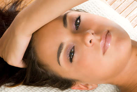beige lips: a nice portrait of young and cute brunette with beautiful eyes Stock Photo