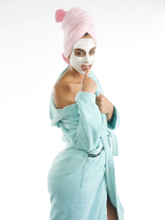 cute and nice girl with face cream mask looking the camera sexy photo