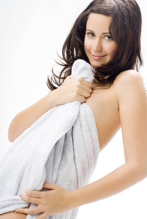 bathrobe: a nice brunette with white towel taking pose in front of the camera playing and smiling Stock Photo