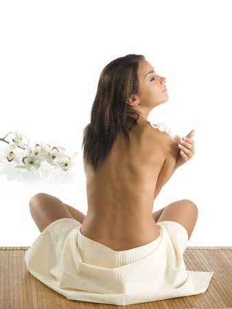 revitalize: very beautiful girl sitting down and showing her sensual  back with creamr Stock Photo