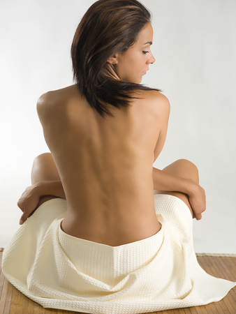 very beautiful girl sitting down and showing her sensual  back Stock Photo