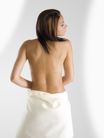 very beautiful girl sitting down and showing her sensual  back Stock Photo - 1665096