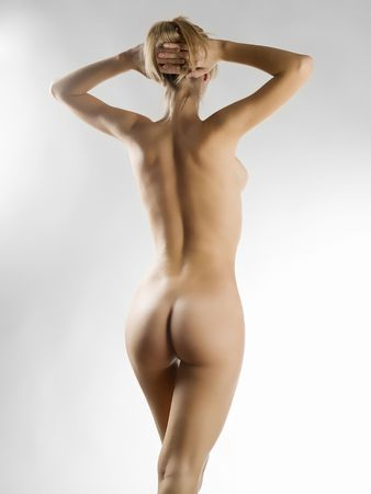 a beautiful young woman showing her naked body