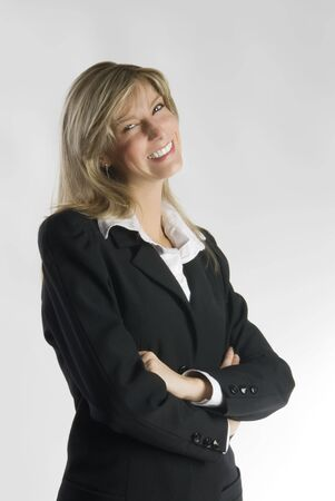 tailleur: blond and attractive young woman in formal black suit making faces