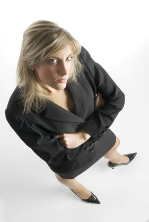 blond and attractive young woman in formal black suit making faces photo