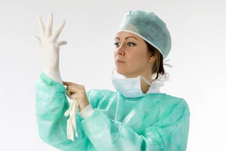 surgical glove: an assistent putting on her gloves before the operation