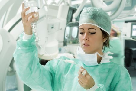 assistant in surgery with meking a i.v. Stock Photo