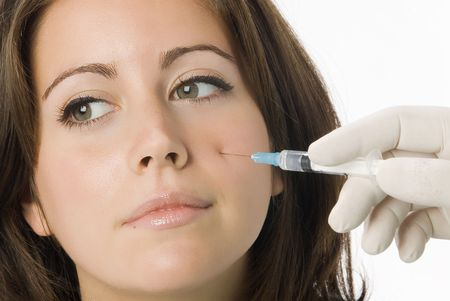 augmentation: Portrait of fresh and beautiful woman getting botox injection Stock Photo