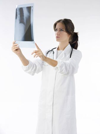 young and nice doctor watching a patient x-ray Stock Photo - 2317352