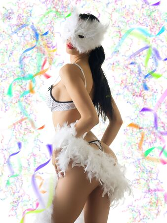 a beautiful young girl in white carnival mask and white lingerie Stock Photo