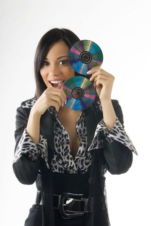 young brunette playing with cd and making nice expression photo