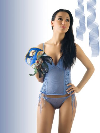 beautiful brunette with blue-sky lingerie and a carnival mask Stock Photo - 2390724
