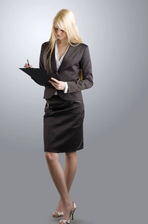 blond and nice working as hostess in formal dress photo