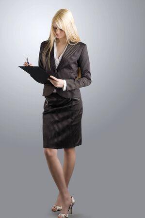 hôtesse: blond et agr�able � travailler comme h�tesse en tenue habill�e