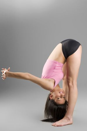 cute gymnast stretching her body before a competition photo