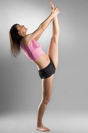 pretty gymnast stretching her legs Stock Photo - 2548158