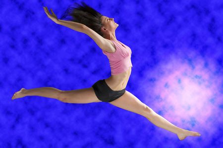 a cute gymnast in a hard jump on a blue background Stock Photo - 2548125