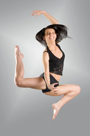 a modern dancer with black dress jumping Stock Photo - 2548120