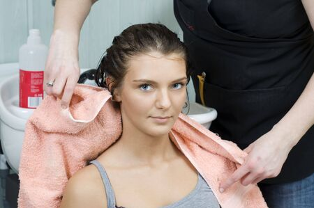 brunette in salon hair getting her hair dryied with a towel Stock Photo - 2584479