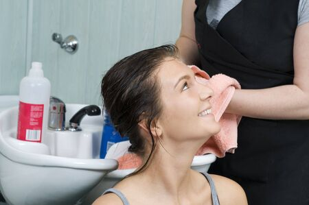 brunette in salon hair getting her hair dryied with a towel Stock Photo - 2584470