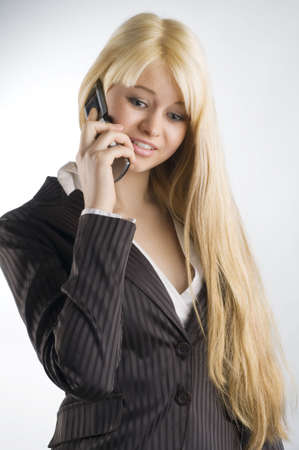 tailleur: nice portrait of blond formal dressed woman talking with mobile