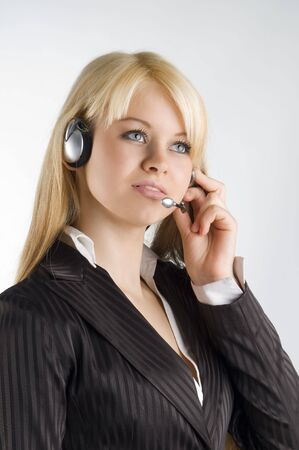 tailleur: cute blond girl with earphone and formal dress