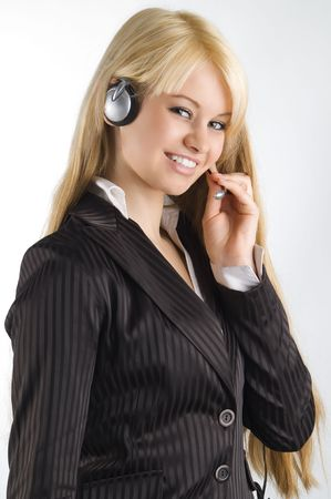 cute blond hostess chatting with earphone and smiling photo