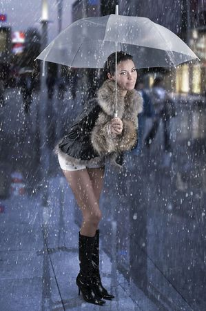 pretty brunette black boot white short under white umbrella