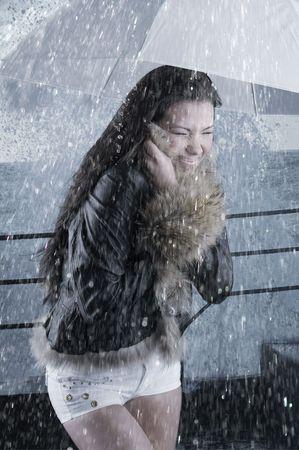 young girl under umbrella photo