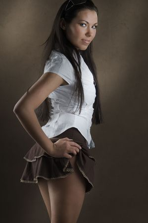 skirt up: young and nice girl with white shirt and up brown short skirt