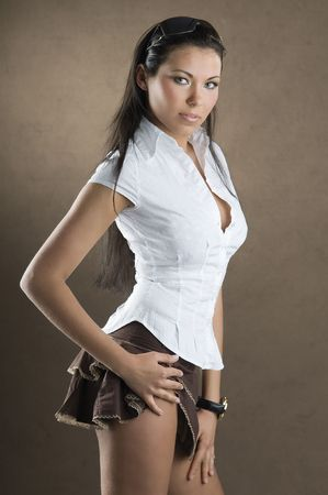 Young And Nice Girl With White Shirt And Up Brown Short Skirt ...