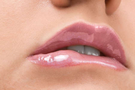 clse up of a red mouth with lipstick and lip gloss Stock Photo - 2790690