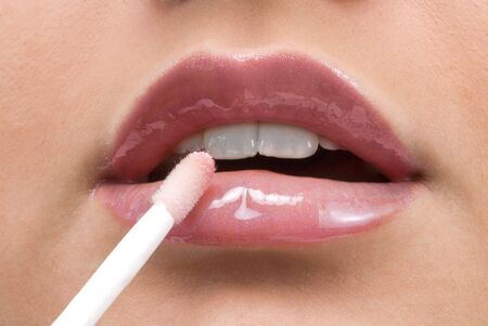 clse up of a red mouth with lipstick and lip gloss Stock Photo - 2790679