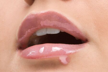 clse up of a red mouth with lipstick and lip gloss dropping down Stock Photo - 2790686