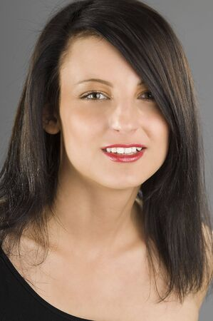 nice portrait of a young and beautiful brunette with red lips  photo