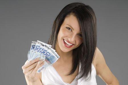 young smiling brunette with a wad 20 euro in her hand photo