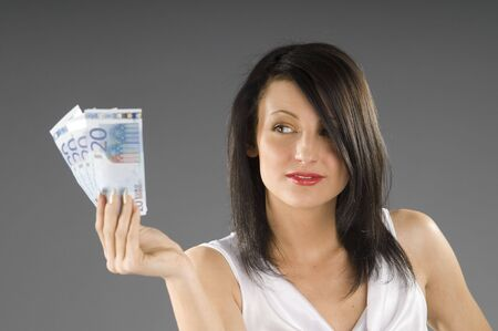 young smiling brunette with 20 euro in her hands Stock Photo - 2812157